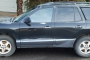 'Hyundai Santa Fe 2001' from the web at 'https://www.salvage-parts.com/imgs/junkcars/2017/332/180/79561511982292-hyundai-santa-fe-2001.jpg'